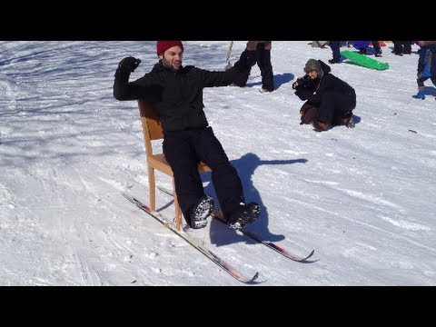 Brooklyn Man Fashions a Snow Sled Out of a Desk Chair & Skis