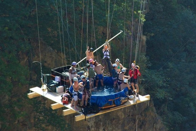 Hot tub suspended from bridge