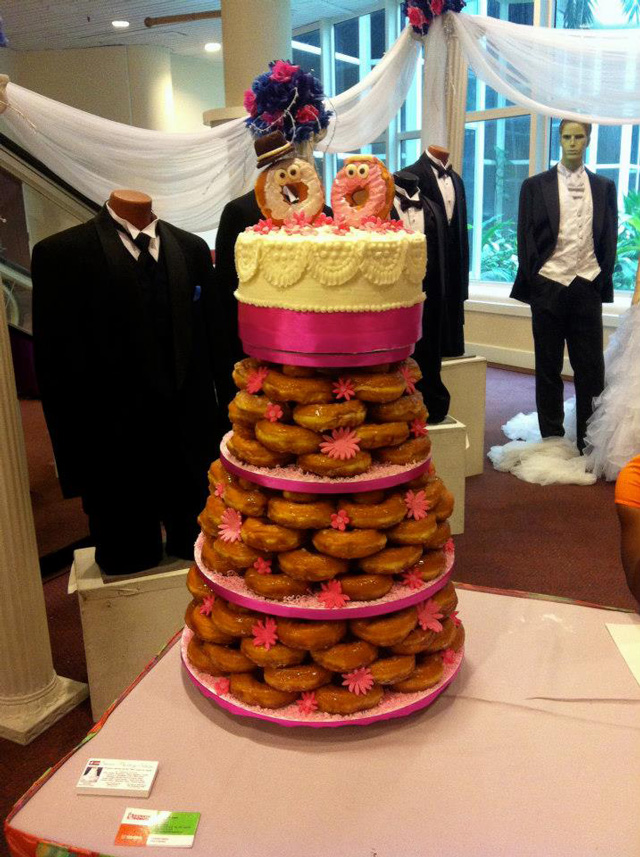 A glazed donut wedding cake made with dunkin donuts on their facebook page dunkin donuts bahamas posted photos of a donut wedding cake a fancy stacked glazed donut creation topped with a traditional cake junglespirit Gallery