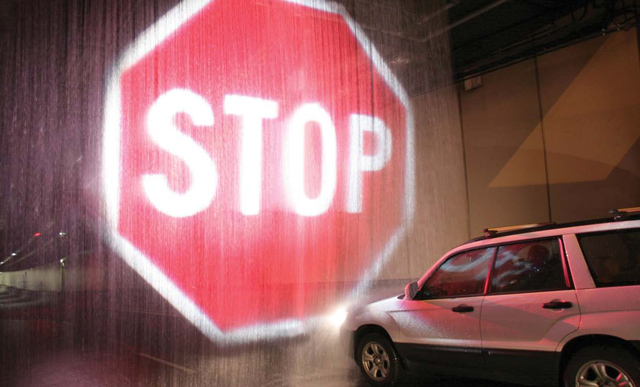 Softstop Barrier System Projects Giant Stop Sign on a Curtain of Water to Stop Motorists in Emergency