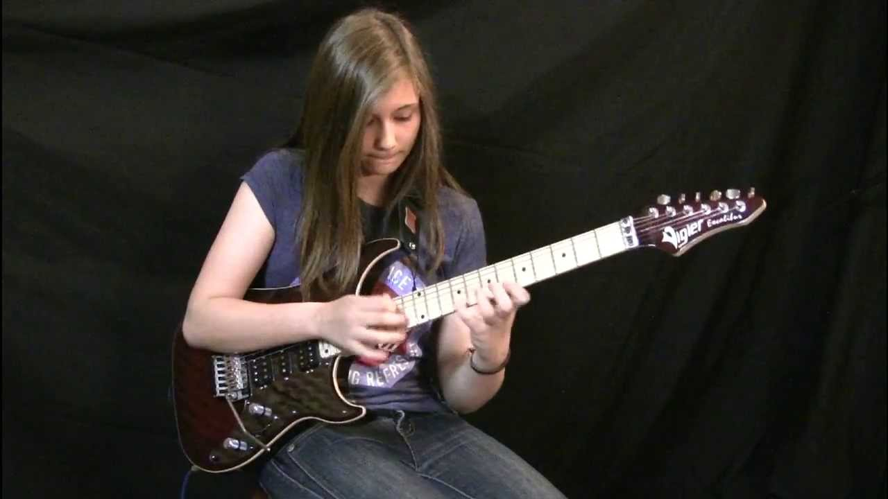 Teenage Girl Plays Van Halen's 'Eruption' Guitar Solo With Laser Precision and An Amused Look on Her Face