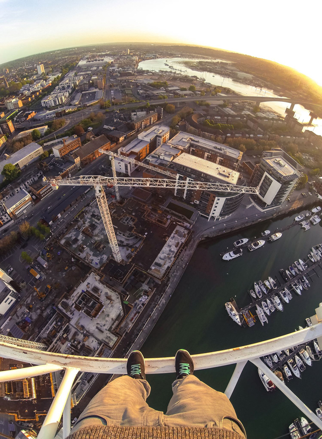 British man climbs construction crane