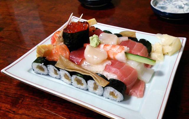 Tank sushi served at japanese restaurant for Aka japanese cuisine menu