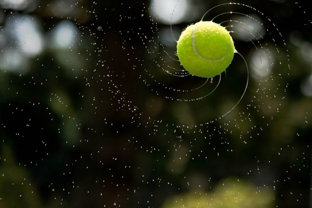 High Speed Photo Shows Water Forming Logarithmic Spirals As It Flies Off a Tennis Ball