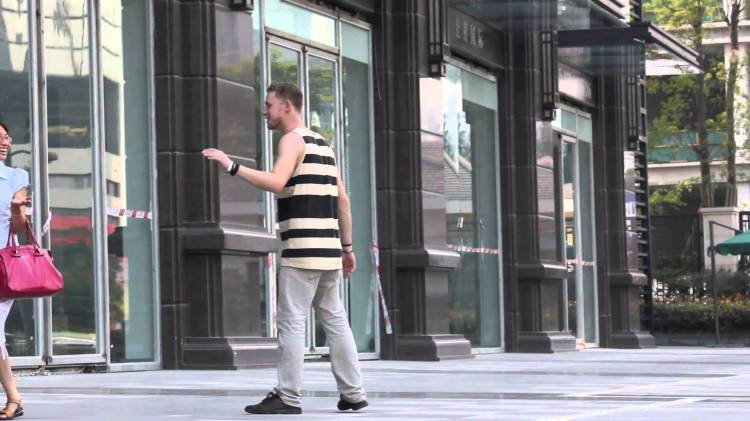 Guy Tries to Hold Hands With Random Strangers in New York and China