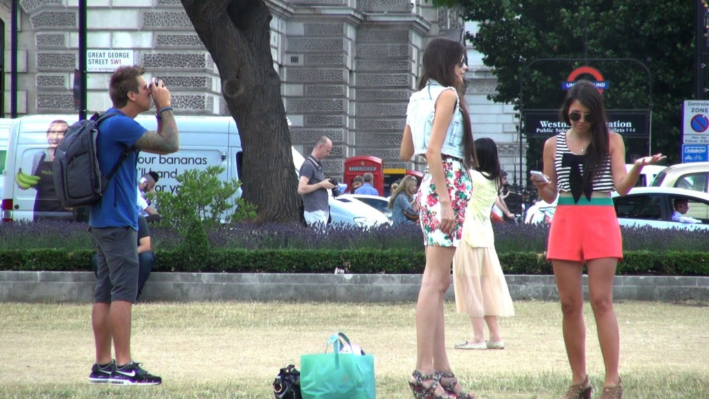 Guys Covertly Spray People in London With a Water Squirting Camera