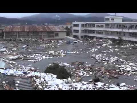 New Footage of the 2011 Japan Tsunami Shows Surging Water Washing Away Buildings, Boats, and Cars