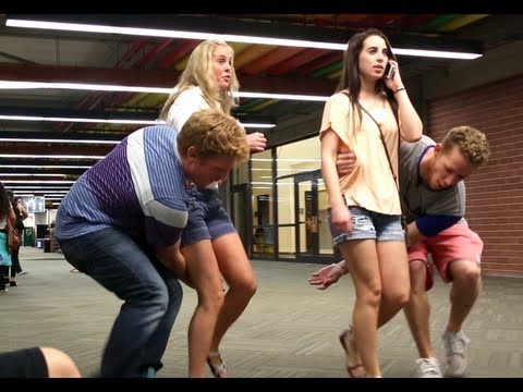Pranksters Sweep Strangers Off Their Feet & Greet Them With a Kiss