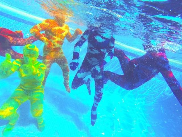 Swimming underwater in Olek crocheted bodysuits
