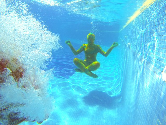 Swimming underwater in Olek crocheted bodysuits