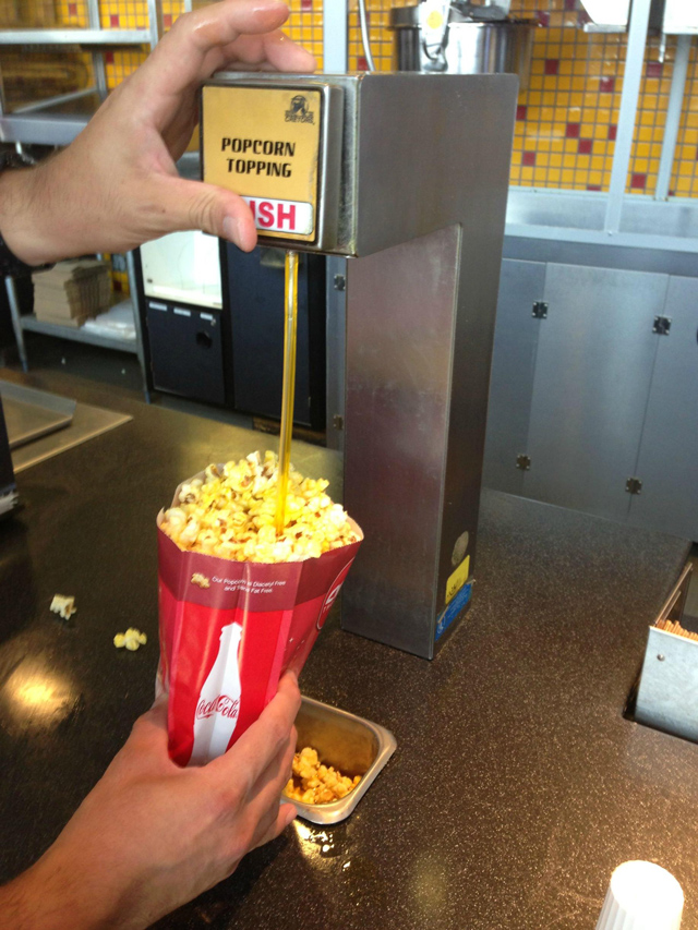 popcorn machine with butter dispenser