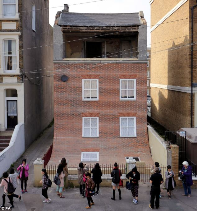 Sliding facade installation by Alex Chinneck