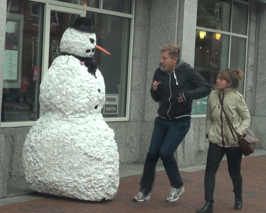 Freaky the Scary Snowman Frightens Unsuspecting People as They Walk Past Him in Boston