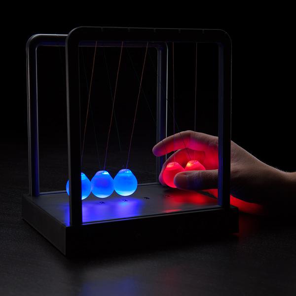 Kinetic Light Newton's Cradle by ThinkGeek