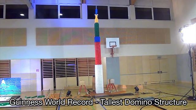Super Tall Domino Structure Falls at the End of 100,101-Piece Domino Course For Guinness World Record