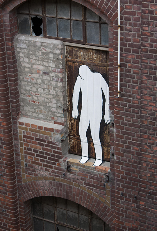 Ghostly Painted Figures in an Abandoned Building in Leipzig