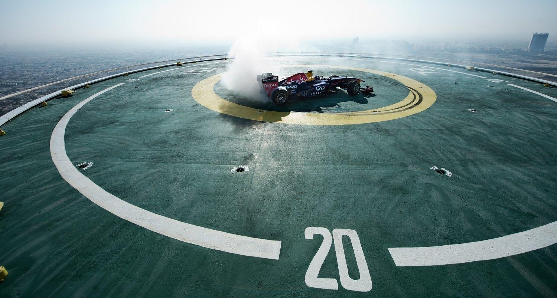 Formula One Race Car Does Donuts On Helipad Atop The Burj Al Arab Hotel In Dubai