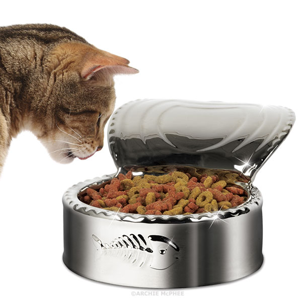 a silver plated cat dish that looks like an open can of cat food. Black Bedroom Furniture Sets. Home Design Ideas