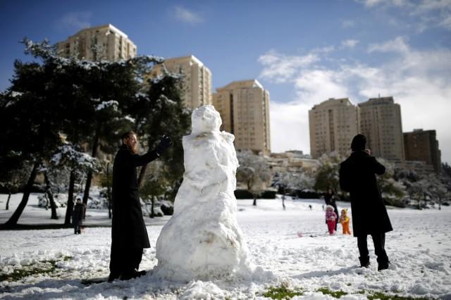 Orthodox Men Build Snowman