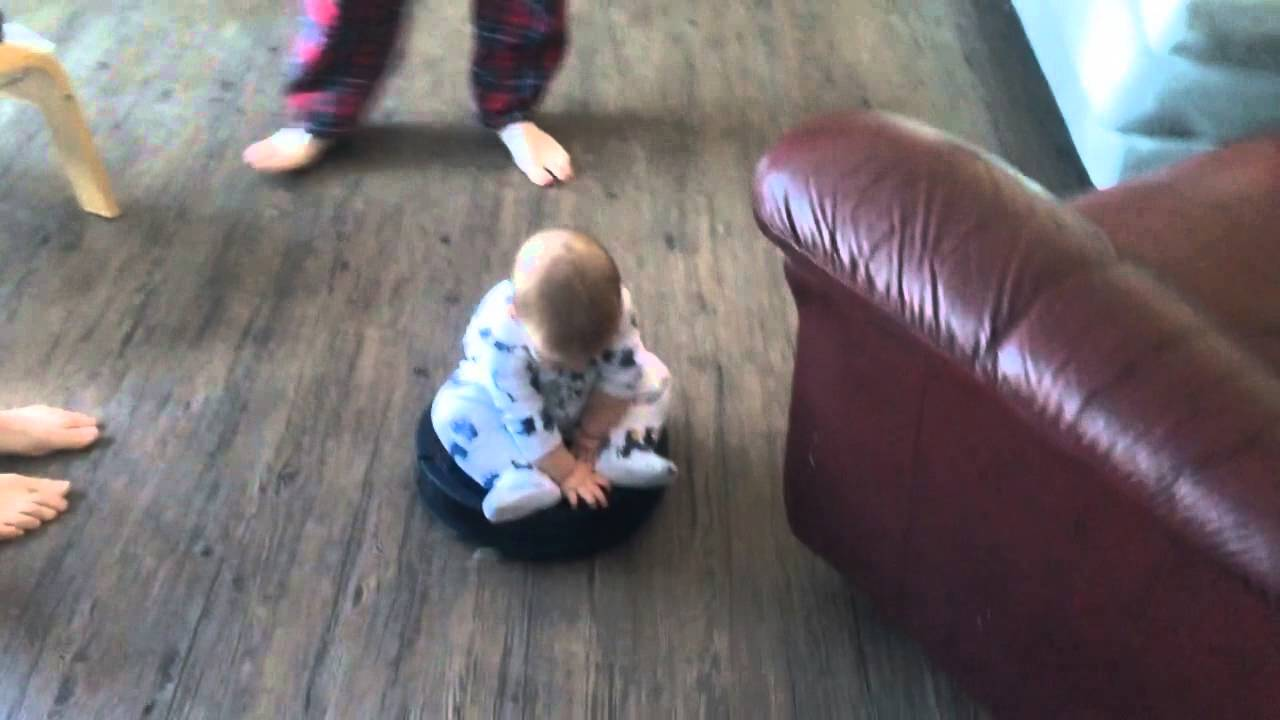 Baby Rides Around on Top of a Roomba Vacuum