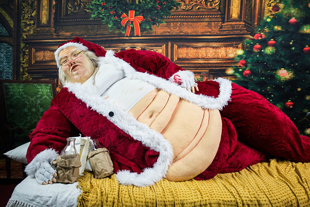 santa the hutt an obese santa claus sculpture made in the likeness