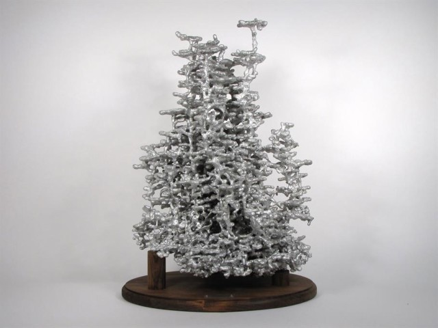 Ant Colony Sculptures Made by Pouring Molten Metal into Ant