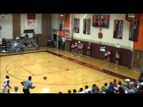 High School Basketball Player Makes an Amazing Behind-the-Back Shot While Running Out of Bounds