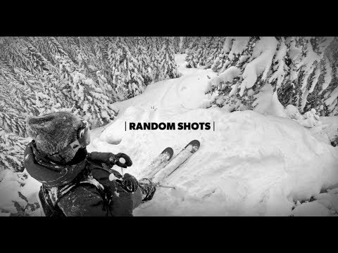 POV Footage of Two Skiers Speeding Downhill Through Dense Forests