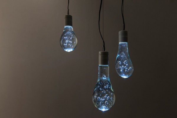 An Led Lamp That Looks Like A Light Bulb Full Of Water