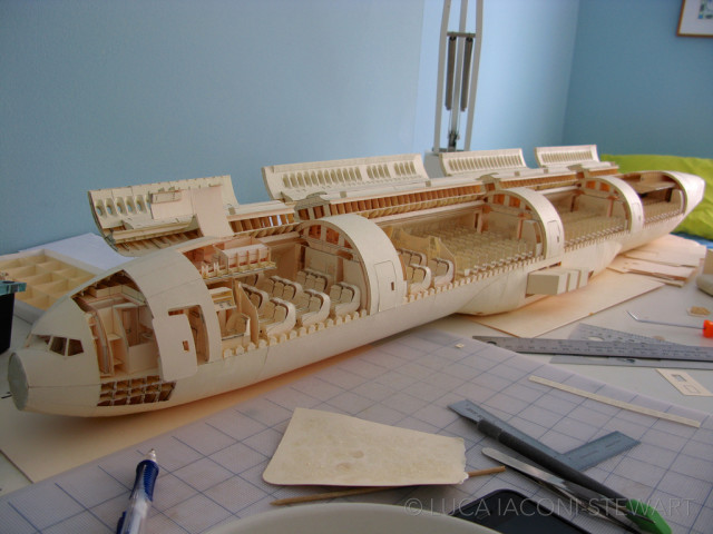an incredibly detailed paper model of a boeing 777 created