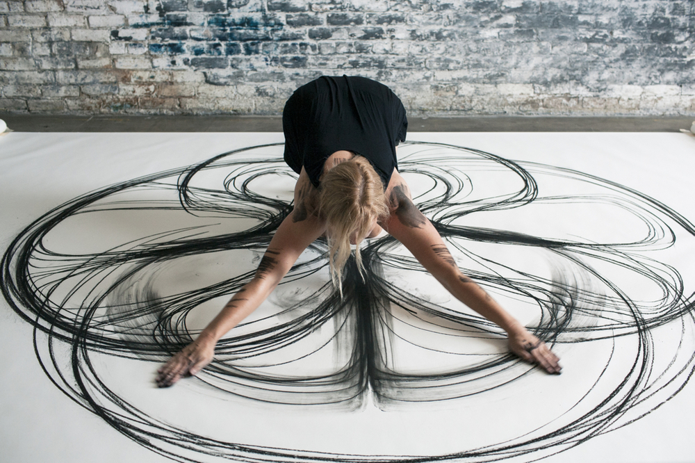 Artist uses her body to draw geometric designs for Body movement drawing