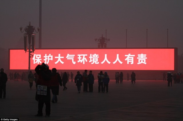 Giant Screens Display Sunrise in Smog Shrouded Beijing