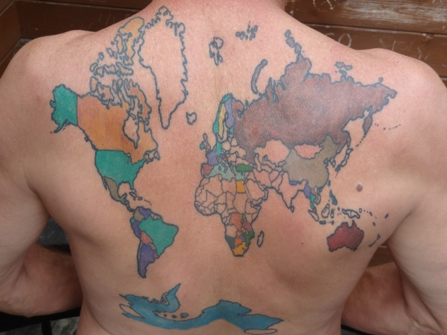 backpacker gets giant world map tattoo on his back colors in the countries he visits on his travels. Black Bedroom Furniture Sets. Home Design Ideas