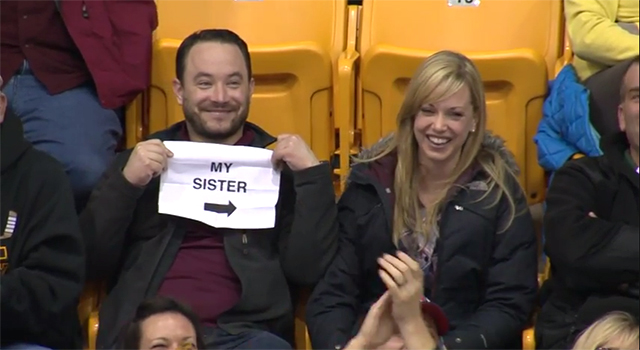 Clever Man Avoids an Awkward Kiss Cam Moment by Holding Up a 'My Sister' Sign During Hockey Game