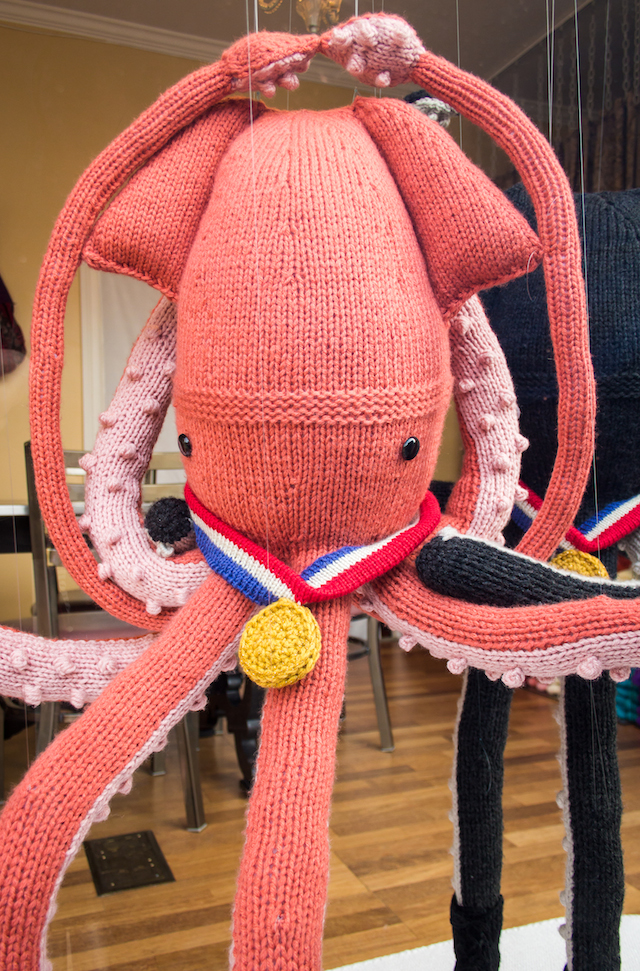 Sisters Create A Winter Olympics Themed Window Display Featuring Knitted Ice Dancing Squids
