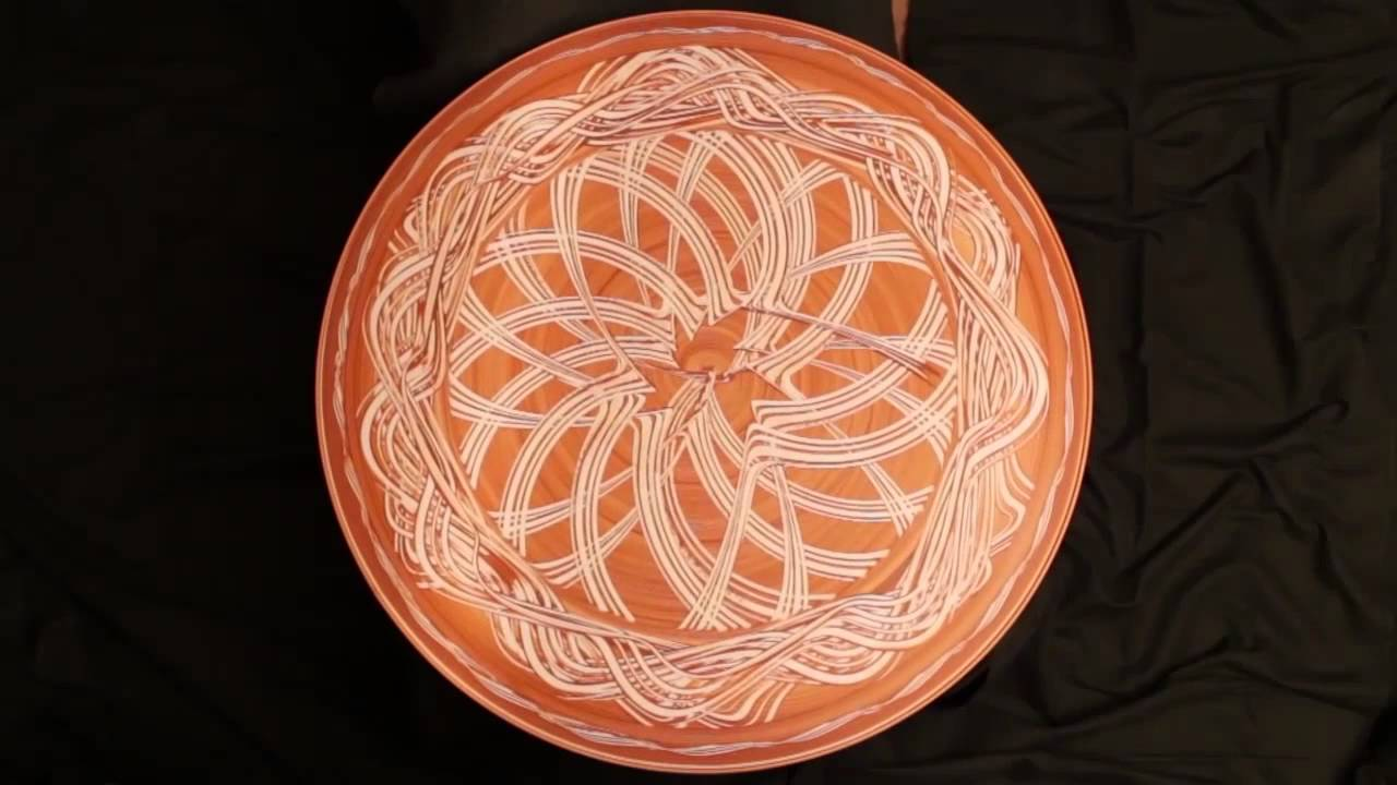 Artist Creates Mesmerizing Patterns in Wet Clay on a Spinning Potter's Wheel