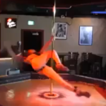 Talented Pole Dancer Performs Astonishing Acrobatic Routine In Empty Strip Club