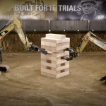Five Caterpillar Excavators Stack Wooden Blocks Making a Giant Tower