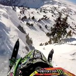 GoPro Video of a Snowmobile Getting Some Serious Air While Going Down the Side of a Cliff