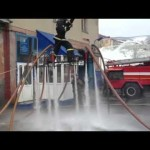 Russian Firefighter Floats on a Platform in the Air With the Help of Six Fire Hoses