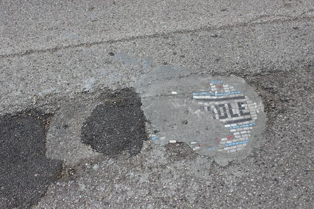 Artist Fills Chicago Potholes with Mosaic Art