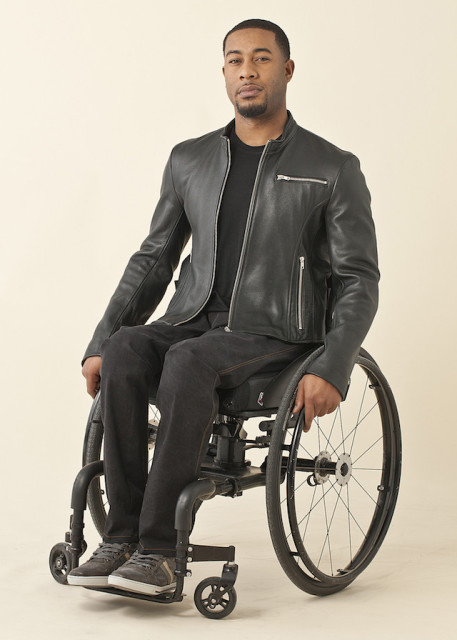 Disabled Black Guy With Braces And Glasses