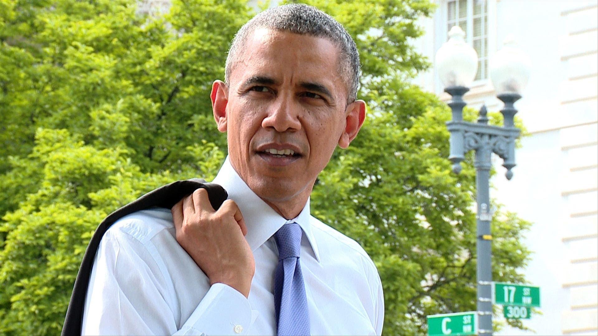 President Barack Obama Takes A Surprise Springtime Walk Around A Washington D.C. Neighborhood