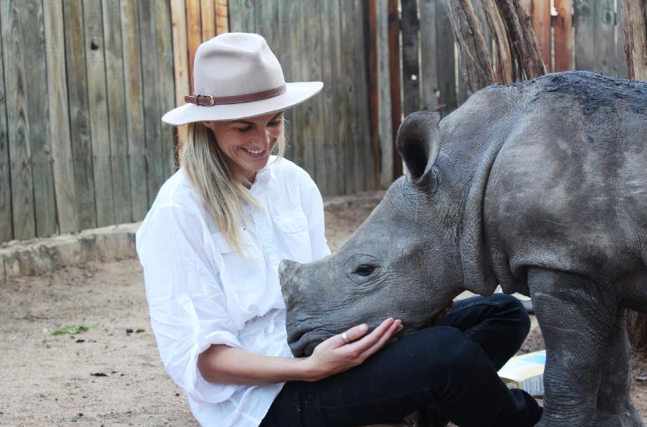 Gertjie the Orphaned Baby Rhino Enjoys the Company of Humans