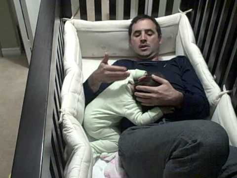 Loving Father Climbs Into Crib to Comfort His Crying Baby ...