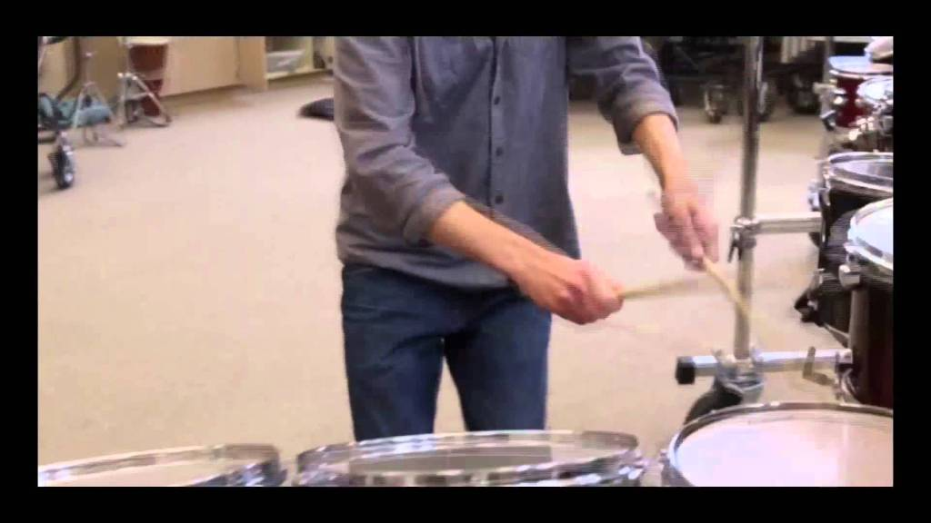 Student Recreates Iconic Drum Fill From Hawaii Five-0 Theme Song Along a Long Line of Drums