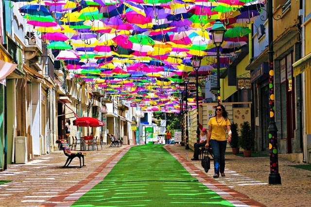 Canopies of Colorful Umbrellas and Beach Balls Cover Streets in Águeda Portugal in a Month-Long Art Installation & Canopies of Colorful Umbrellas and Beach Balls Cover Streets in ...