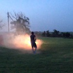 A Video of a Man Firing a Contraption Made From Five Roman Candles Taped Together