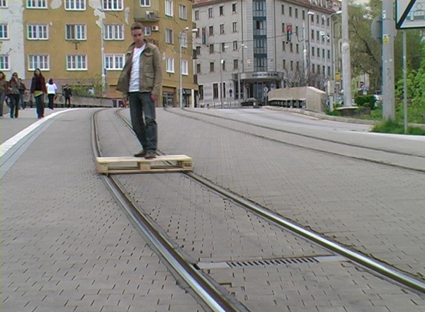 Skating on a Shipping Pallet That Is Modified to Run on Street Car Tracks
