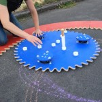 A Giant Spirograph That Measures Eight Feet Across and Writes On the Sidewalk in Chalk